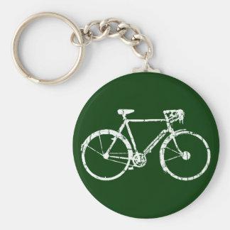 white bicycle key ring
