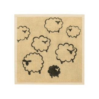 White & Black Sheep on Cream Background Wood Print