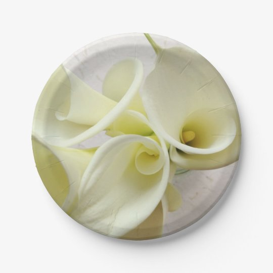 White calla lilies from above paper plate