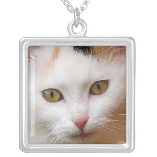 White cat pendant