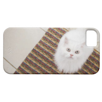 White cat sitting on mat case for the iPhone 5