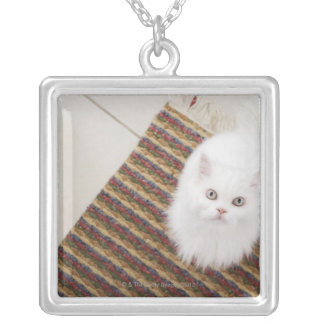 White cat sitting on mat square pendant necklace