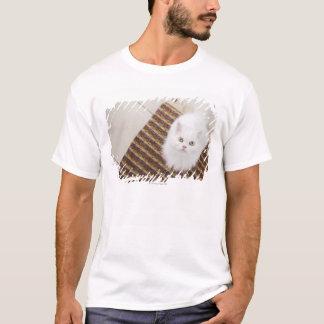White cat sitting on mat T-Shirt