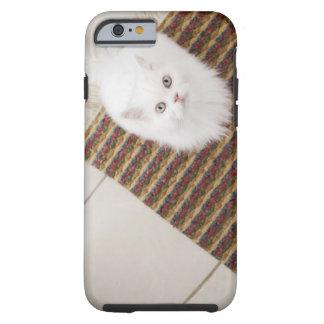 White cat sitting on mat tough iPhone 6 case