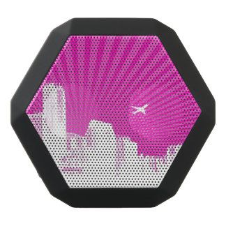 White city on pink background black bluetooth speaker