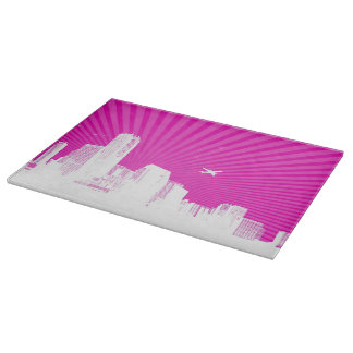 White city on pink background cutting board