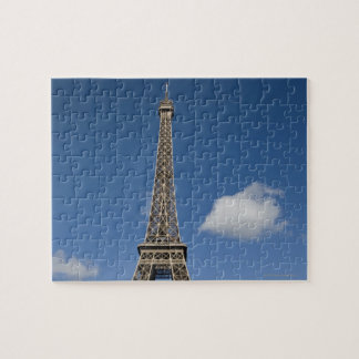 white clouds against blue sky behind the Eiffel Jigsaw Puzzle