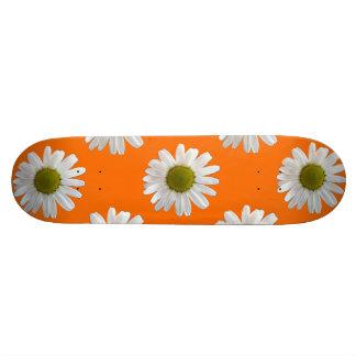 White daisies on orange 21.6 cm skateboard deck