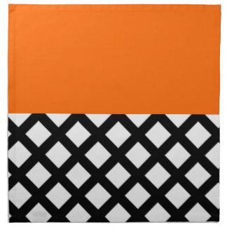 white diamonds in black and orange napkin