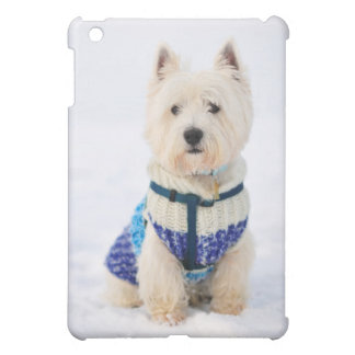 White dog in clothes in the snow. iPad mini covers