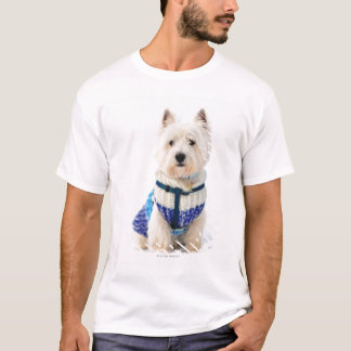 White dog in clothes in the snow. T-Shirt
