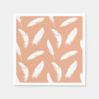 White feather print on soft peach disposable napkins