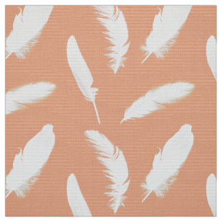 White feather print on soft peach fabric