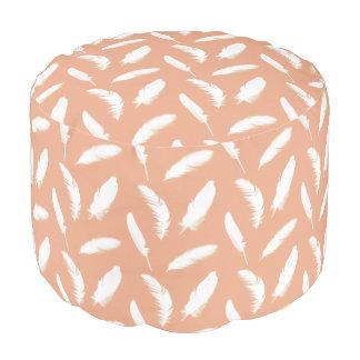 White feather print on soft peach round pouf
