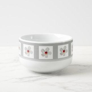 white flower framed in gray soup mug