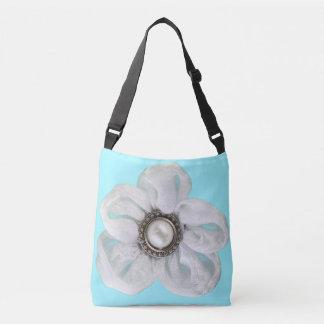 White flower on pale cyan crossbody bag
