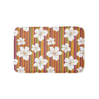 White flowers on a striped background bath mat