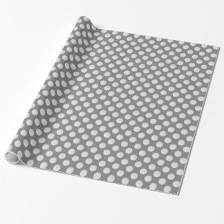 White Golf Balls on Medium Gray Wrapping Paper