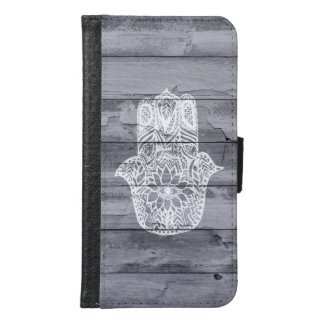 White hand drawn Hamsa hand of fatima on wood