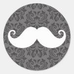 White handlebar moustache on grey damask pattern round sticker