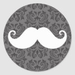White handlebar moustache on grey damask pattern round stickers
