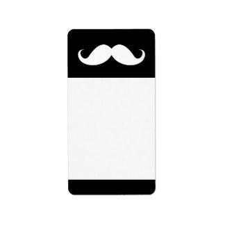 White handlebar mustache on black background address label