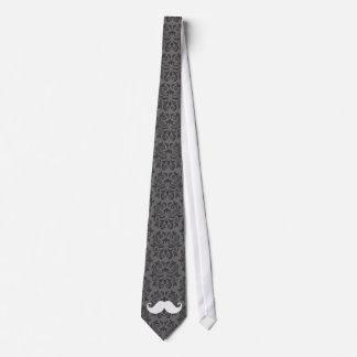 White handlebar mustache on gray damask pattern tie