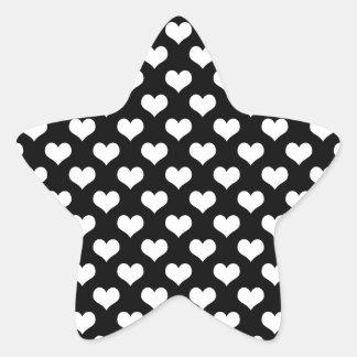 White hearts pattern on a black background star sticker