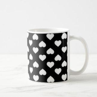 White hearts pattern on black coffee mug