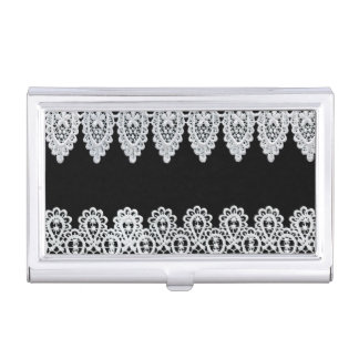 White lace forms a delicate border against black business card holder