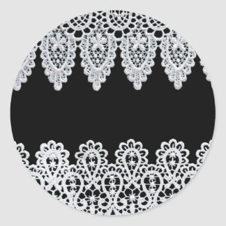 White lace forms a delicate border against black classic round sticker