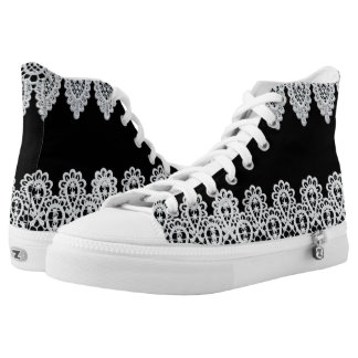 White lace forms a delicate border against black high tops