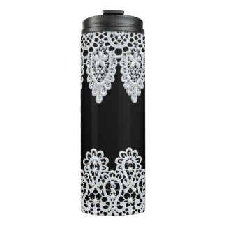 White lace forms a delicate border against black thermal tumbler