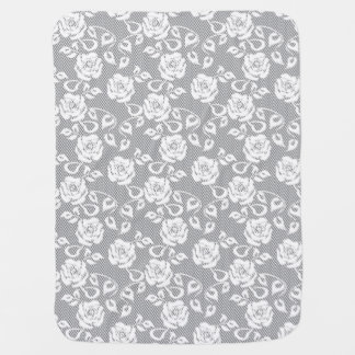 White lace pattern on gray background baby blanket