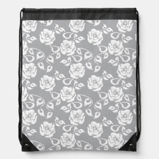 White lace pattern on gray background drawstring bag