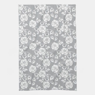 White lace pattern on gray background tea towel