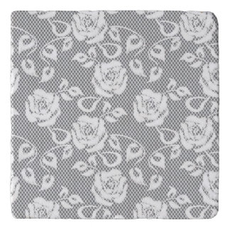 White lace pattern on gray background trivet