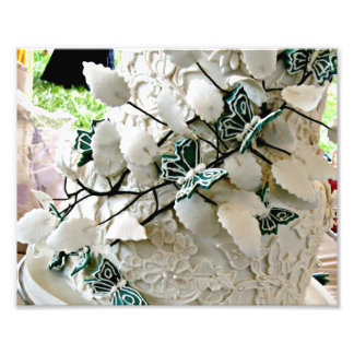 White lacy wedding cake with green butterfies photographic print