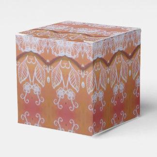 white leaves on orange favor box