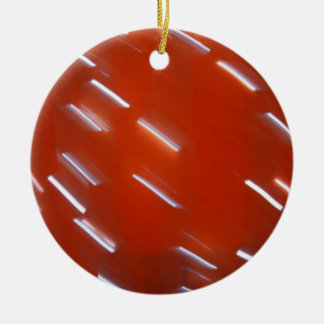 White LED light bulb on a red wall blurred in moti Round Ceramic Decoration
