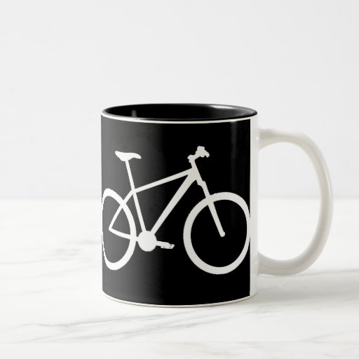 White mountain bike on black mug.