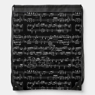 white musical notes on black drawstring bag