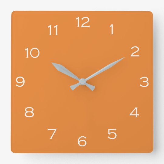 White Numbers On Orange Wall Clock