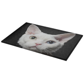 White odd-eyed cat cutting board