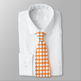 White polka dots against a orange background tie