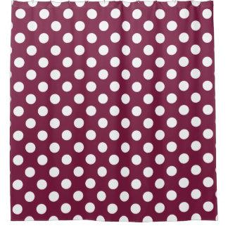 White polka dots on burgundy shower curtain