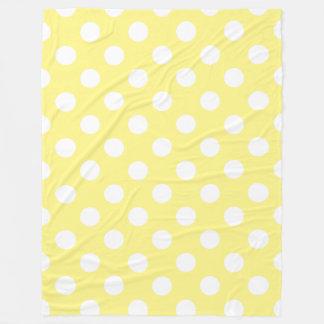 White polka dots on lemon yellow fleece blanket
