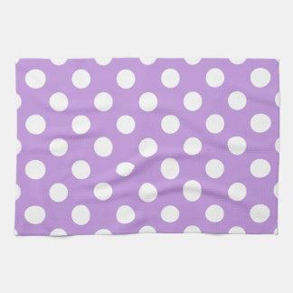 White polka dots on lilac tea towel