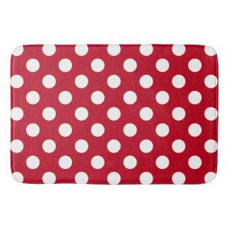 White polka dots on red bath mats