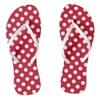 White polka dots on red flip flops